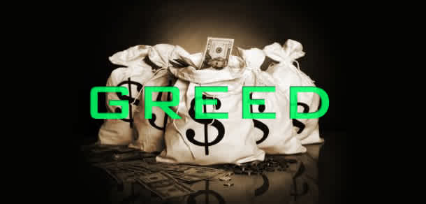 "This is a photo of a bag of money. The bags have money signs on them and the photo has the word ""GREED"" written across from it."