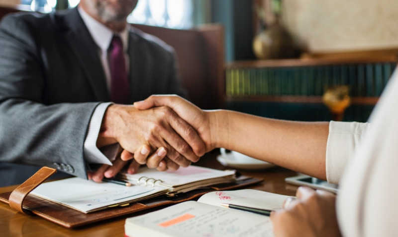 Attorney shaking a clients hand