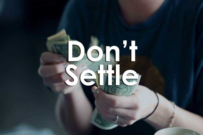 "This is a photo of a female counting money. The words ""Don't Settle"" are written in white font across the photo."