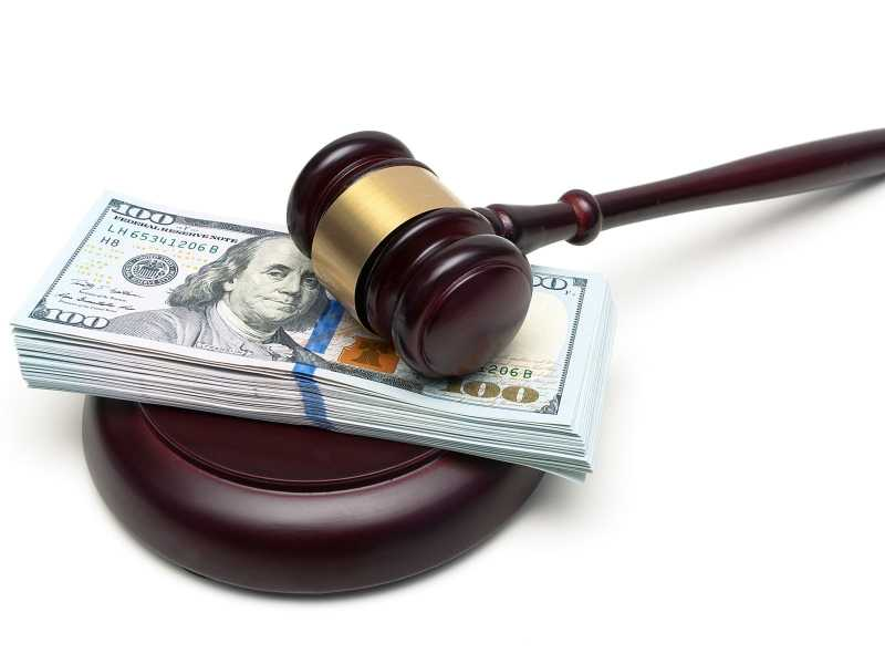 This is a photo of a gavel and and 100 dollar bills.