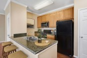 Kitchen with granite countertops and bar seating