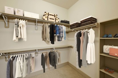 Large closet with built in shelves and shoe rack