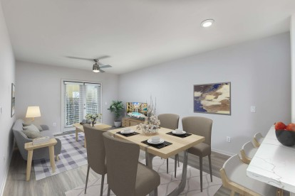Dining area alongside kitchen with bar seating and quartz countertops
