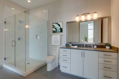 Camden Music Row Apartments Penthouse bathroom with full vanity and enclosed shower