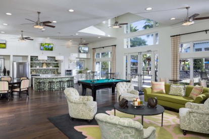 Clubhouse with tvs pool billiards table shuffleboard and gaming station