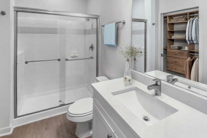 Bathroom with white quartz countertops and walk in shower