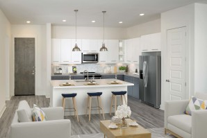 Open-concept living room and kitchen with large island and bar seating