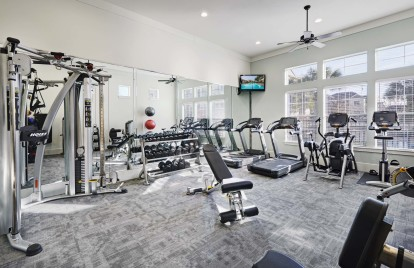 24 hour fitness center with cardio equipment and free weights