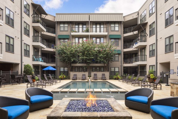 Resort style pool with firepit