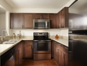 Kitchen with energy efficient stainless steel appliances including microwave