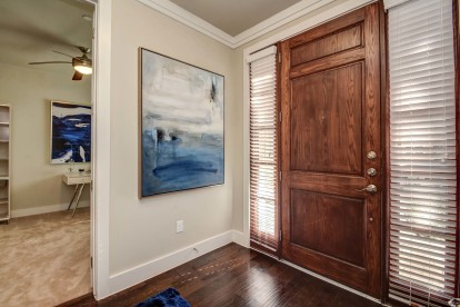 The townhomes entrance with wood flooring and den