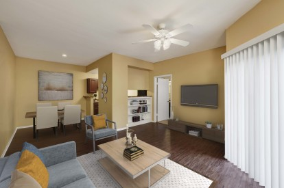 Living and dining room with built in shelving wood look flooring and ceiling fan