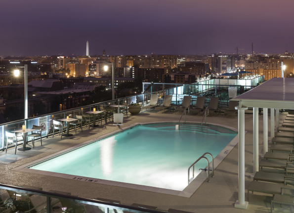 Nighttime pool and views of Washington D.C. from Camden NoMa