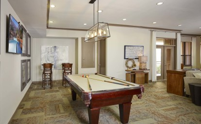 Resident game room with billiards and bar stools