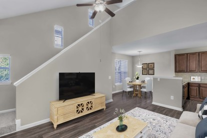 Townhome floor plan living and dining room on lower level with wood look flooring and ceiling fan