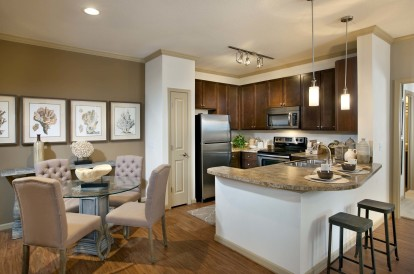 Open concept kitchen with pantry and energy efficient appliances including microwave