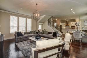 The townhomes open concept living dining kitchen with crown molding