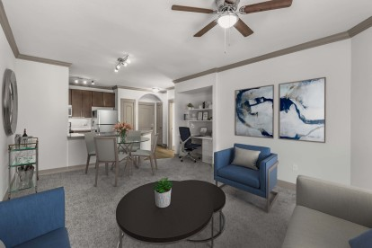 Open-concept living and dining room with carpet, ceiling fan, and space to work from home.