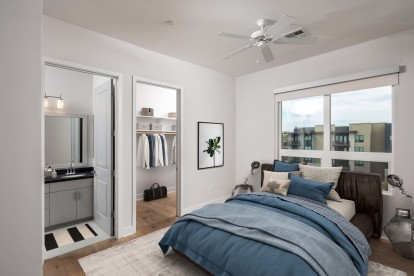 Penthouse bedroom with ensuite bathroom walk in closet and ceiling fan
