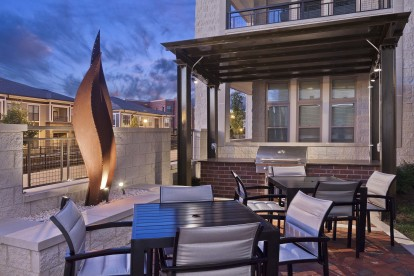 Outdoor seating and grill in the evening
