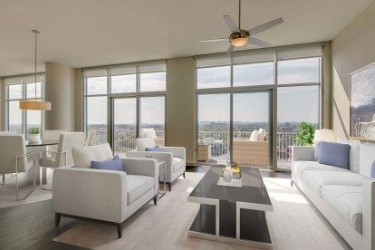 Camden Music Row Apartments Penthouse living room with floor-to-ceiling windows, large balcony with a view, ceiling fans, and hardwood-style flooring