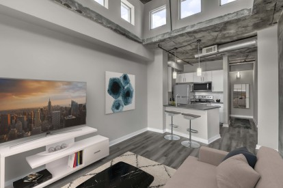 Contemporary midrise apartment living room with lofted ceilings