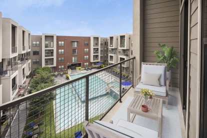 Private balcony overlooking community pool
