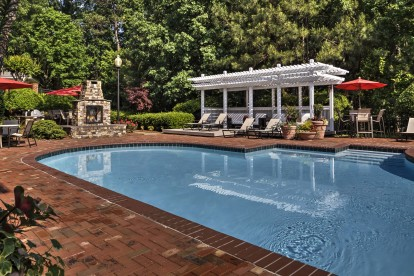Outdoor resort style pool with fire pit