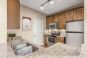 Kitchen with granite countertops and double sink