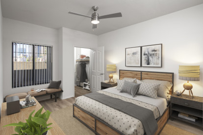 Contemporary style bedroom with large window, ceiling fan, and walk-in closet