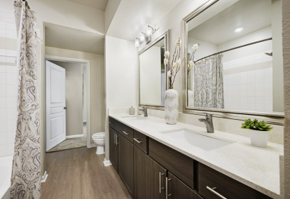 Contemporary-style bathroom with framed mirrors at Camden Farmers Market Apartments in Dallas, TX