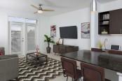 Uba tuba finishes kitchen with island overlooking living room