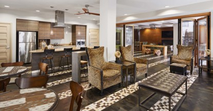 Indoor outdoor resident lounge with entertaining kitchen and comfortable seating