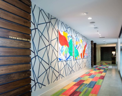 Hallway outside resident clubroom with colorful decor
