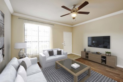 Living room with crown molding wood style flooring and ceiling fan