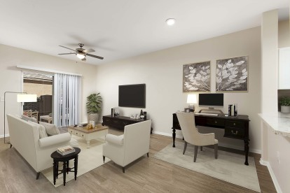 Open concept home office living room with ceiling fan and patio