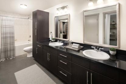 Urban style bathroom with double sink vanity