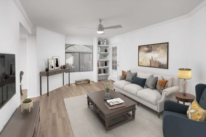 Living room with ceiling fan, built-in shelves and and patio