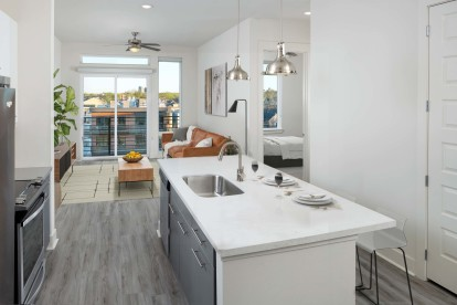 Kitchen with large islands, pendant lighting, white upper and gray lower cabinets