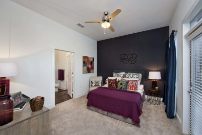 White quartz finishes bedroom with ceiling fan