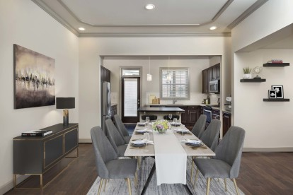 Townhome dining room and kitchen with hardwood flooring and custom finishes