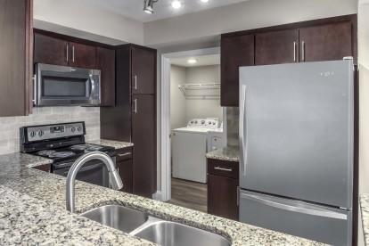 Kitchen with granite countertops and espresso cabinets