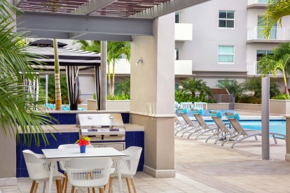 Poolside bbq grills and plenty of seating outdoors