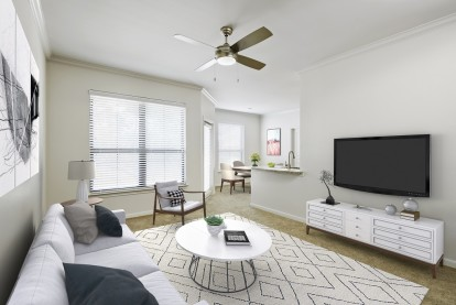 Contemporary-style living and dining room with tv at Camden Farmers Market Apartments in Dallas, TX