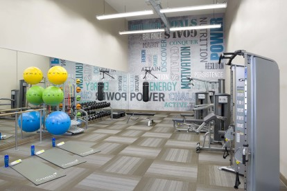24 hour fitness center with strength training machines free weights and yoga equipment