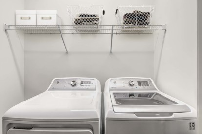 Full size washer dryer side by side with shelving above