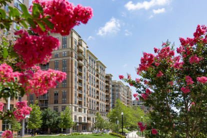 Front exterior of Camden Potomac Yard with beautiful flowers