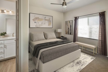 Townhome main bedroom with ceiling fan and ensuite bathroom