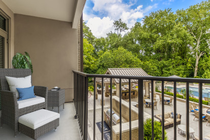 Balcony overlooking pool courtyard and 18th hole of Carolina Country Club