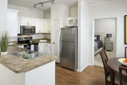 Kitchen with stainless steel appliances and large pantry